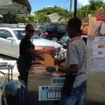 Diane serves customer with her cash cow hot dog cart