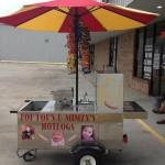 vendor has pictures of grandchildren on cart