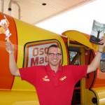 Oscar Mayer Truck Driver holds up Ben's Course Book
