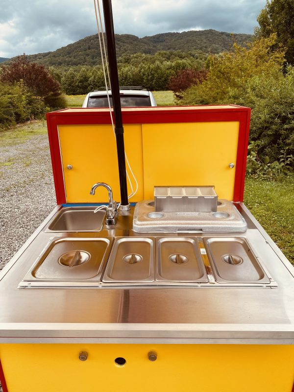 cart top with pans and lids