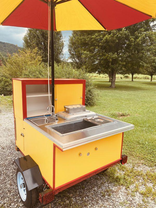 hot dog cart with umbrella